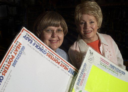 (From left) Mary Russell Sarao and Barbara Russell Pitts, inventors of Ghostline posterboard, are shown in 2003. The product hit stores in 1997.