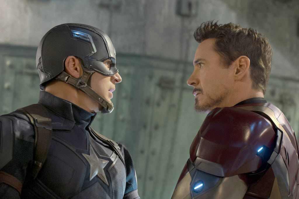 """Two of Marvel's biggest stars and leading Avengers square off in """"Captain America: Civil War"""": The film's title character, played by Chris Evans, left, and Tony Stark, portrayed by Robert Downey Jr. in another smooth turn. MUST CREDIT: Zade Rosenthal, Marvel"""