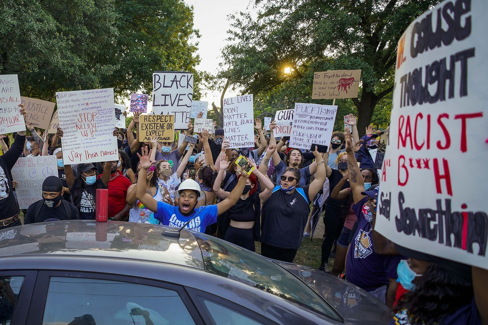 A group of demonstrators gathers at Lake Cliff Park as protests continue after the death of George Floyd on Tuesday, June 2, 2020, in Dallas. Because of the city imposed 7:00 p.m. curfew, the group moved from Dallas City Hall to outside the curfew zone in Oak Cliff.