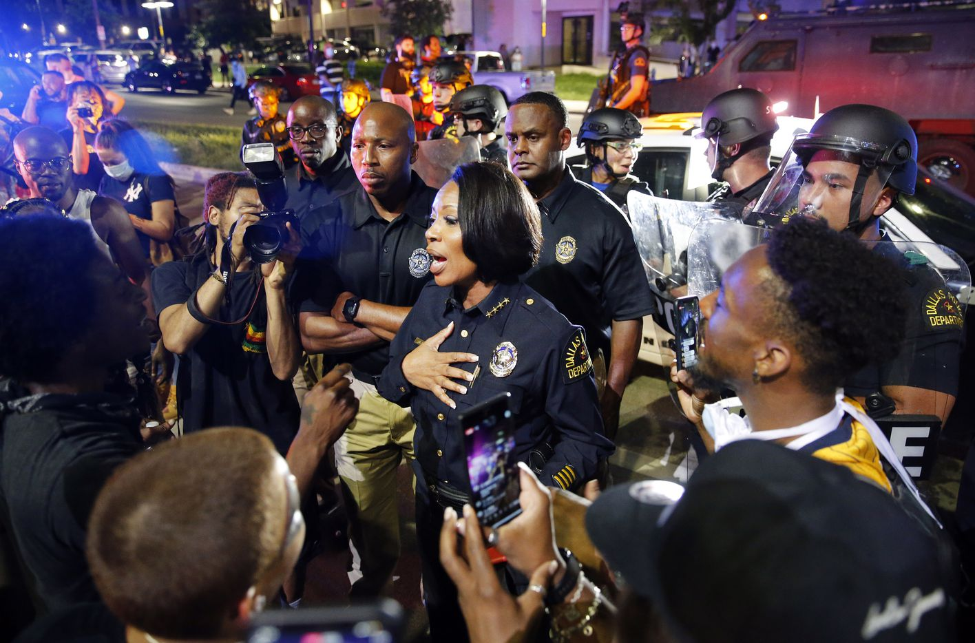 Dallas Police Chief Reneé Hall confronts protestors at Young St. and S. Griffin St. in downtown Dallas, Friday, May 29, 2020. People were marching in protest of the in-custody death of George Floyd when they confronted Dallas Police tactical officers and tear gas was fired.