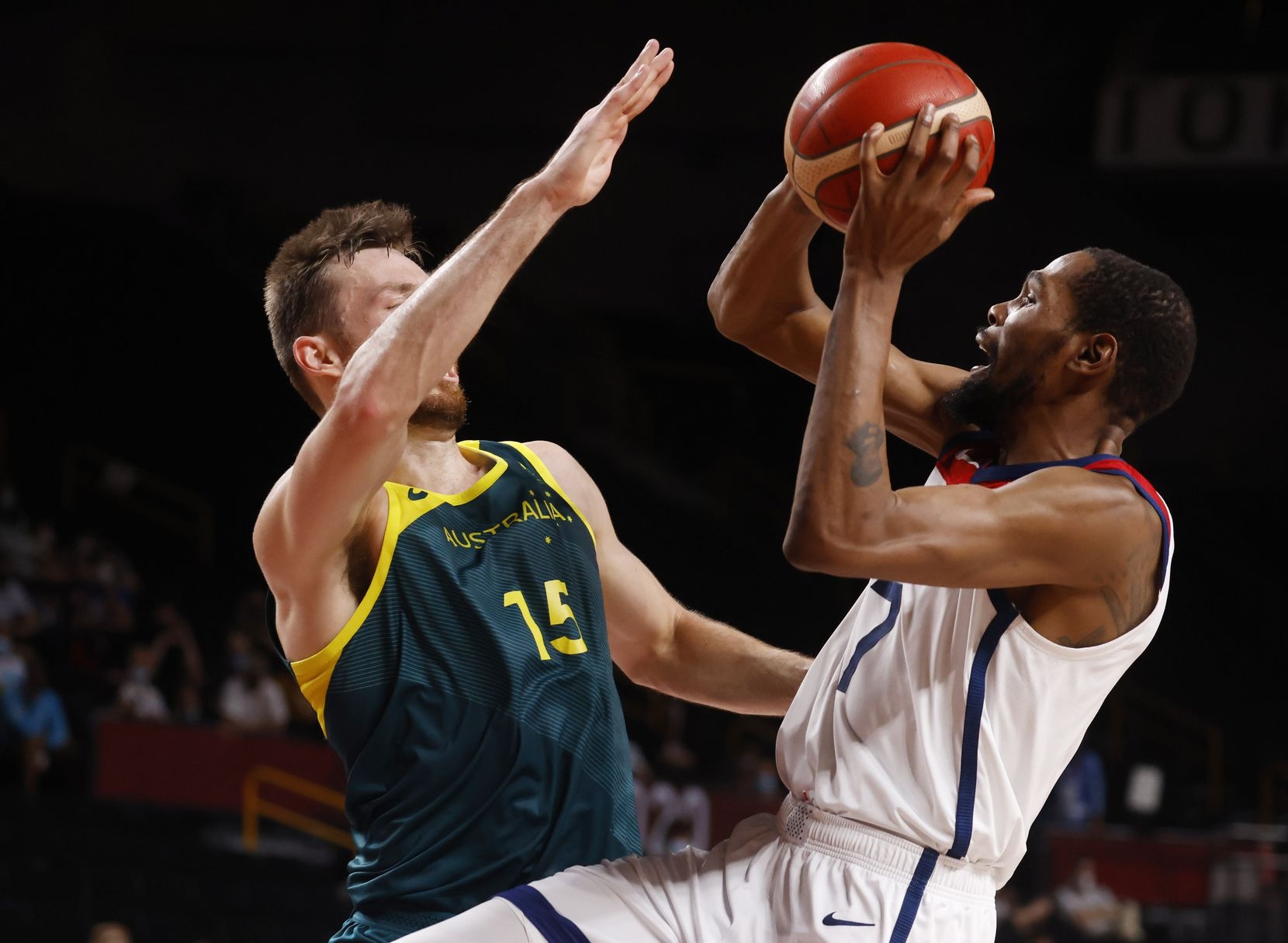 USA's Kevin Durant (7) shoots as he is defended by Australia's Nic Kay (15) during the first half of a men's basketball semifinal at the postponed 2020 Tokyo Olympics at Saitama Super Arena, on Thursday, August 5, 2021, in Saitama, Japan. USA defeated Australia 97-78 to advance to the gold medal game. (Vernon Bryant/The Dallas Morning News)