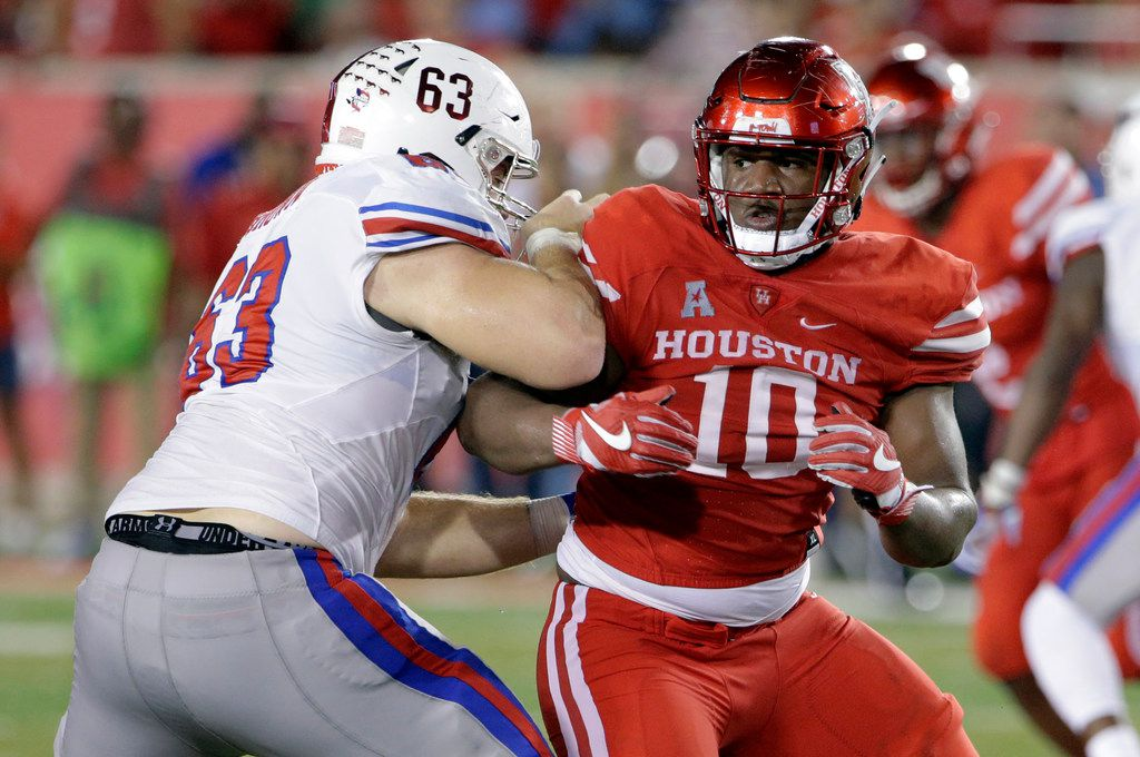FILE - In this Oct. 7, 2017, file photo, SMU offensive lineman Evan Brown (63) blocks Houston defensive tackle Ed Oliver (10) during an NCAA college football game in Houston.  At 6-foot-3 and 290, Oliver combines power, quickness and rare sideline-to-sideline speed for an interior lineman. Houston will push him as a Heisman Trophy contender, but he is more likely to be the first pick in next year's draft. (AP Photo/Michael Wyke, File)