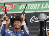 Kyle Larson fires a pair of pistols in Victory Lane as he celebrated his win after driving the number 5 Chevrolet car past the checkered flag. The NASCAR Autotrader EchoPark Automotive 500 race was held at Texas Motor Speedway in Fort Worth on October 16, 2021.