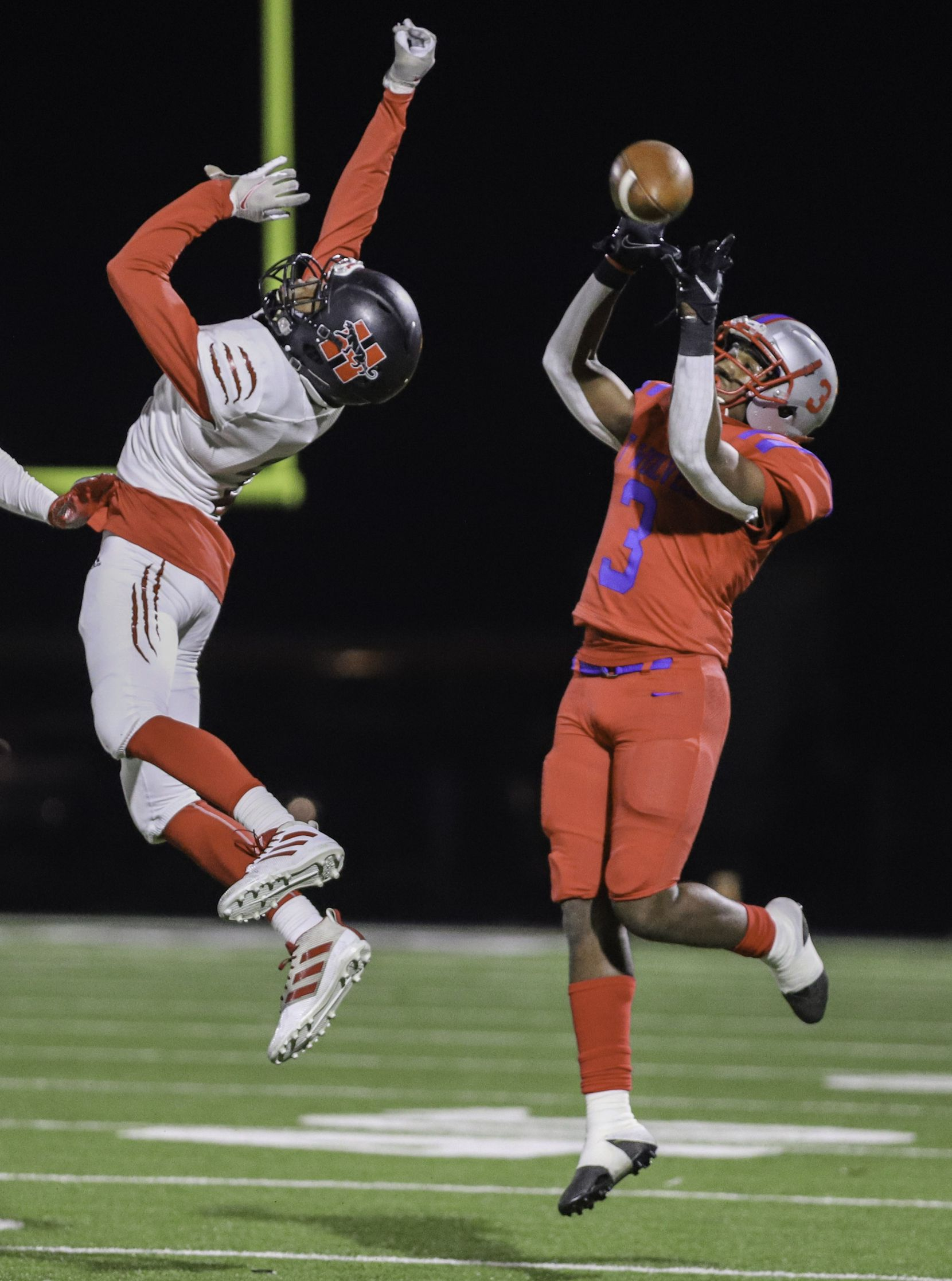 Spruce wide receiver Adrian Wickware (3) drops a pass over Hillcrest defensive back Reggie Williams (2) during the first half at James Ray Henry Stadium in Seagoville, Texas, Friday, December 4, 2020. (Elias Valverde II / Special Contributor)