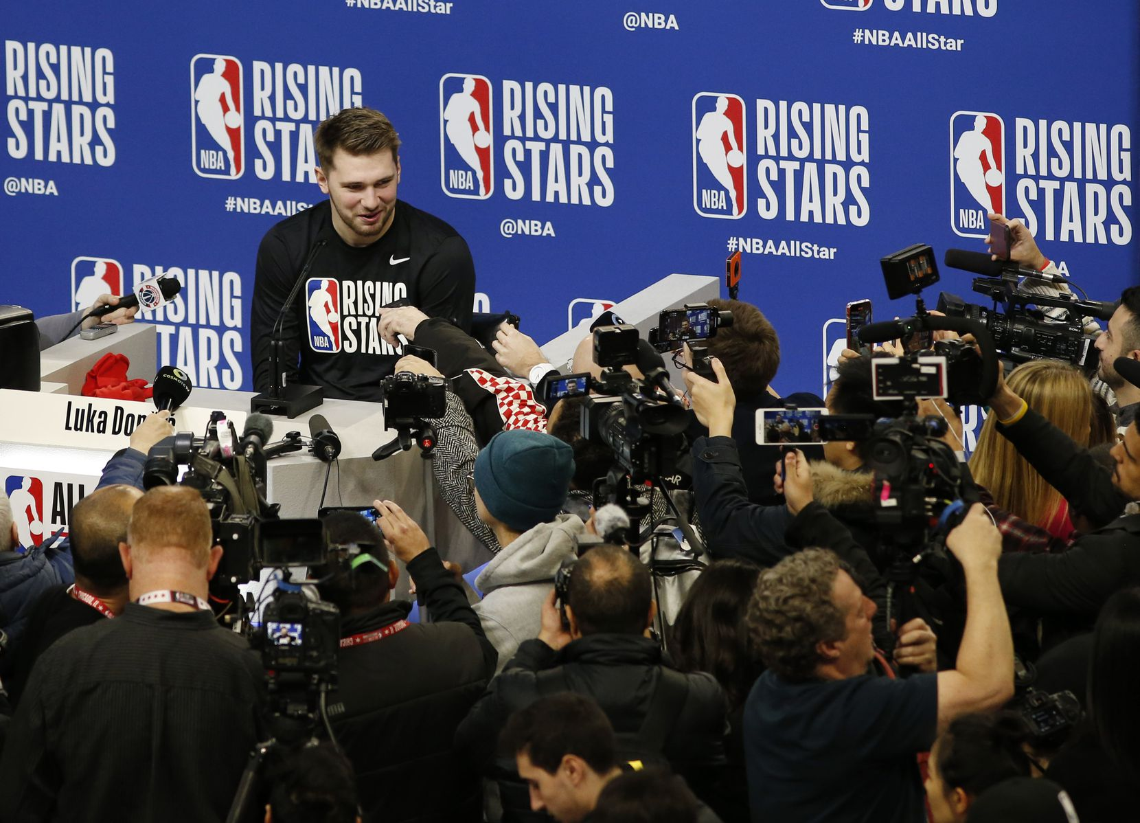 Dallas Mavericks forward Luka Doncic (77) answers questions from the media during NBA Rising Stars practice and media availability during NBA All Star 2020 at Wintrust Arena in Chicago on Friday, February 14, 2020.