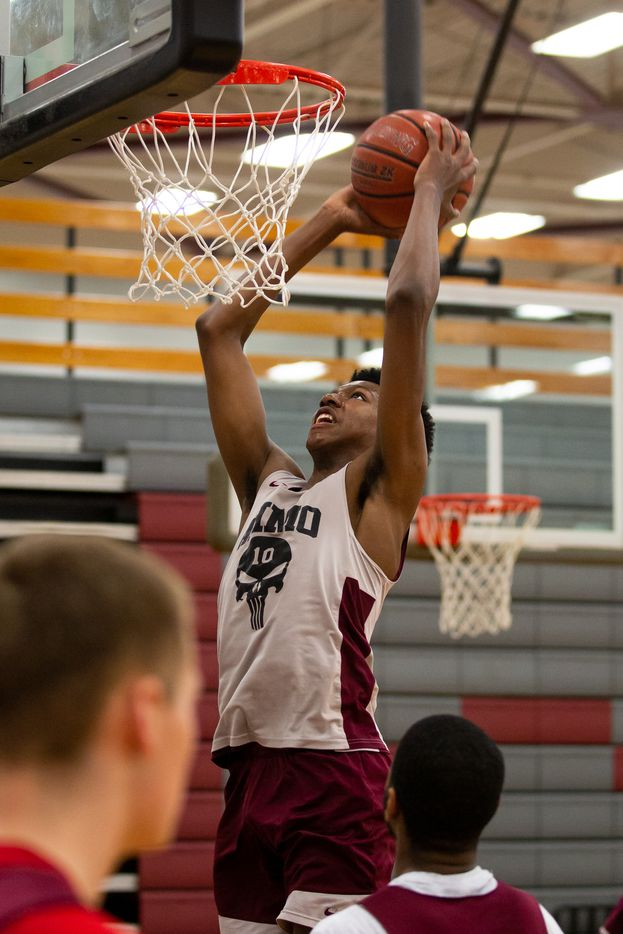 Wylie High School's Cory Wells (10) lands a dunk during practice at Wylie High School on March 11, 2020 in Wylie, Texas. (Kara Dry/Special Contributor)