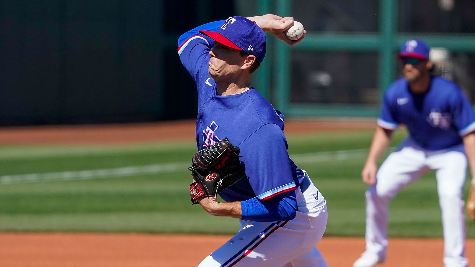 Texas Rangers pitcher Kyle Gibson delivers during the first inning of a spring training game against the San Francisco Giants at Surprise Stadium on Monday, March 1, 2021, in Surprise, Ariz.