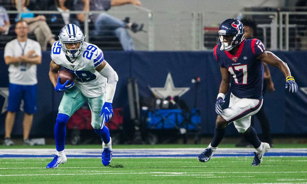 Dallas Cowboys defensive back C.J. Goodwin (29) runs the ball after an interception with Houston Texans wide receiver Vyncint Smith (17) of an NFL game between the Dallas Cowboys and the Houston Texans on Saturday, August 24, 2019 at AT&T Stadium in Arlington.