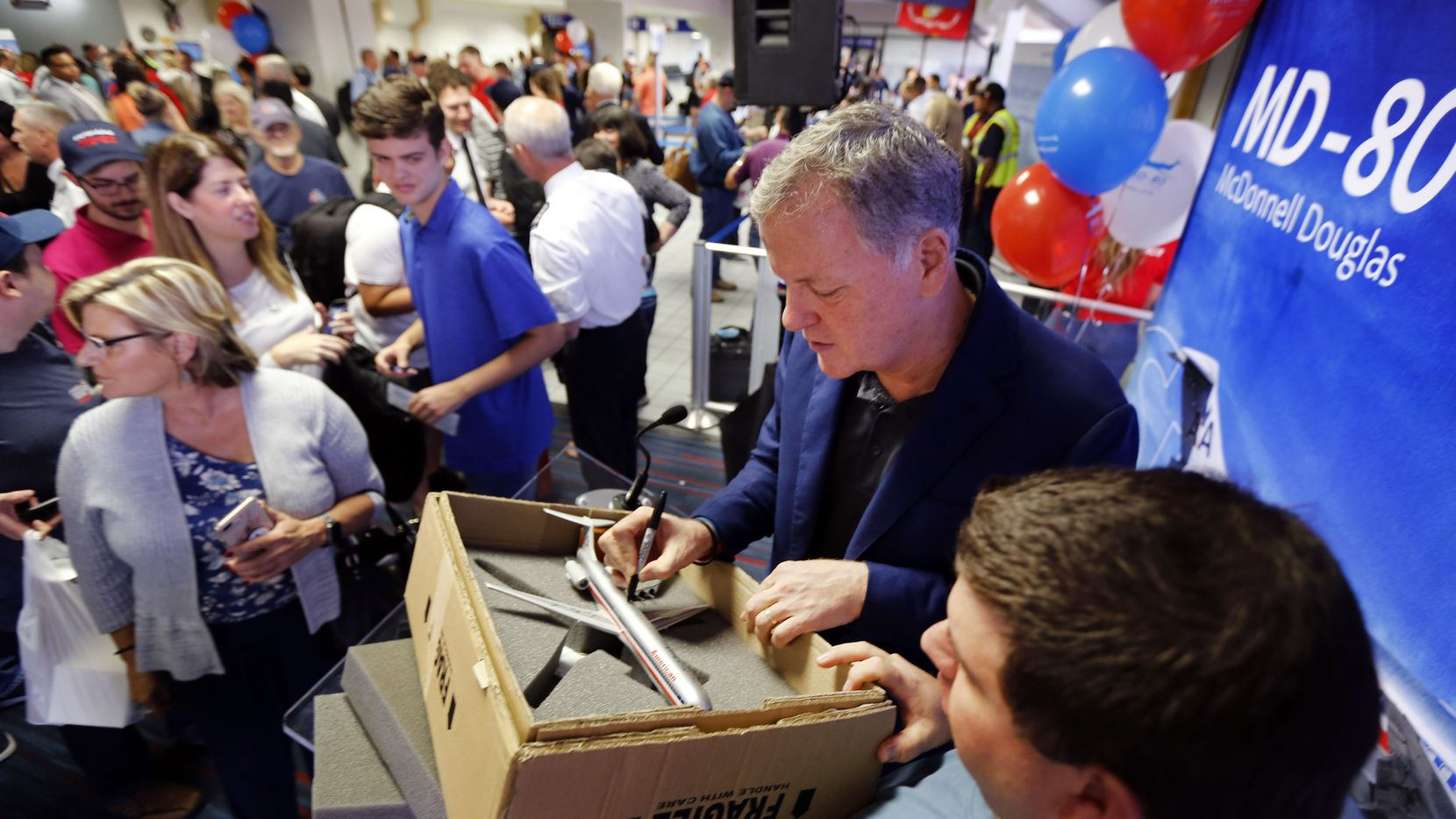 American Airlines CEO Doug Parker signed a model of an American MD-80 for Don Collins of Cleveland. Collins flew in the morning of Sept. 4, 2019, to join the festivities associated with American's final MD-80 revenue flight, which departed DFW International Airport for Chicago. The airline was retiring its final four MD-80s, which had been in service since the 1980s.