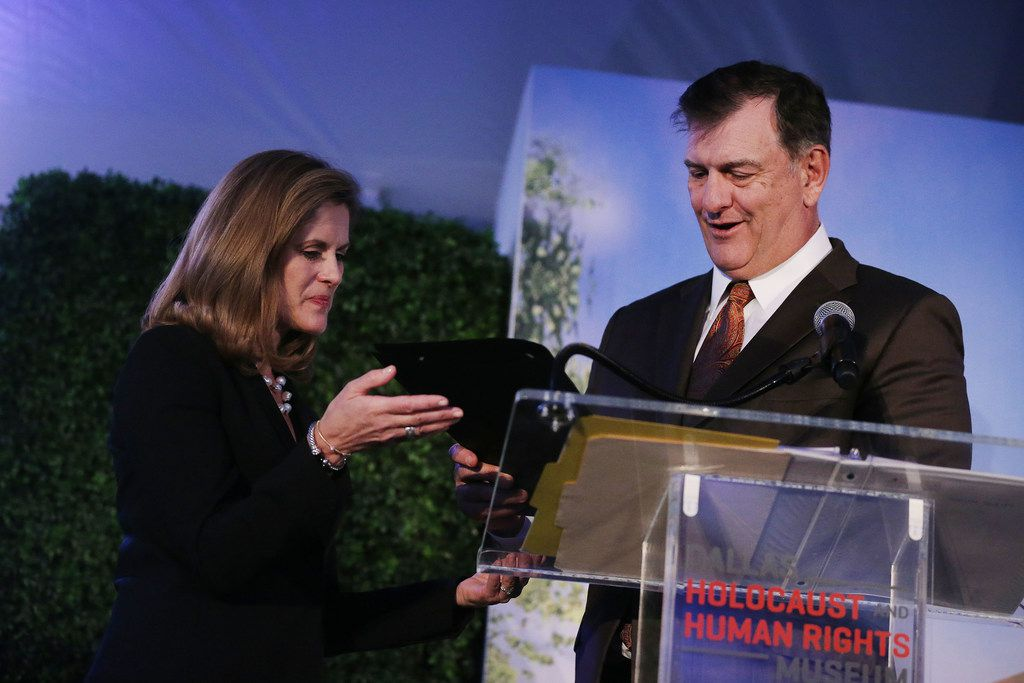 Mary Pat Higgins, president and CEO of the Dallas Holocaust Museum, is offered a special recognition by Dallas Mayor Mike Rawlings at the groundbreaking ceremony for the new Dallas Holocaust and Human Rights Museum in Dallas. The ceremony also honored Dallas-Fort Worth Holocaust survivors. At 300 N. Houston St., the new museum will be 51,000 square feet and is scheduled to open in the summer of 2019.