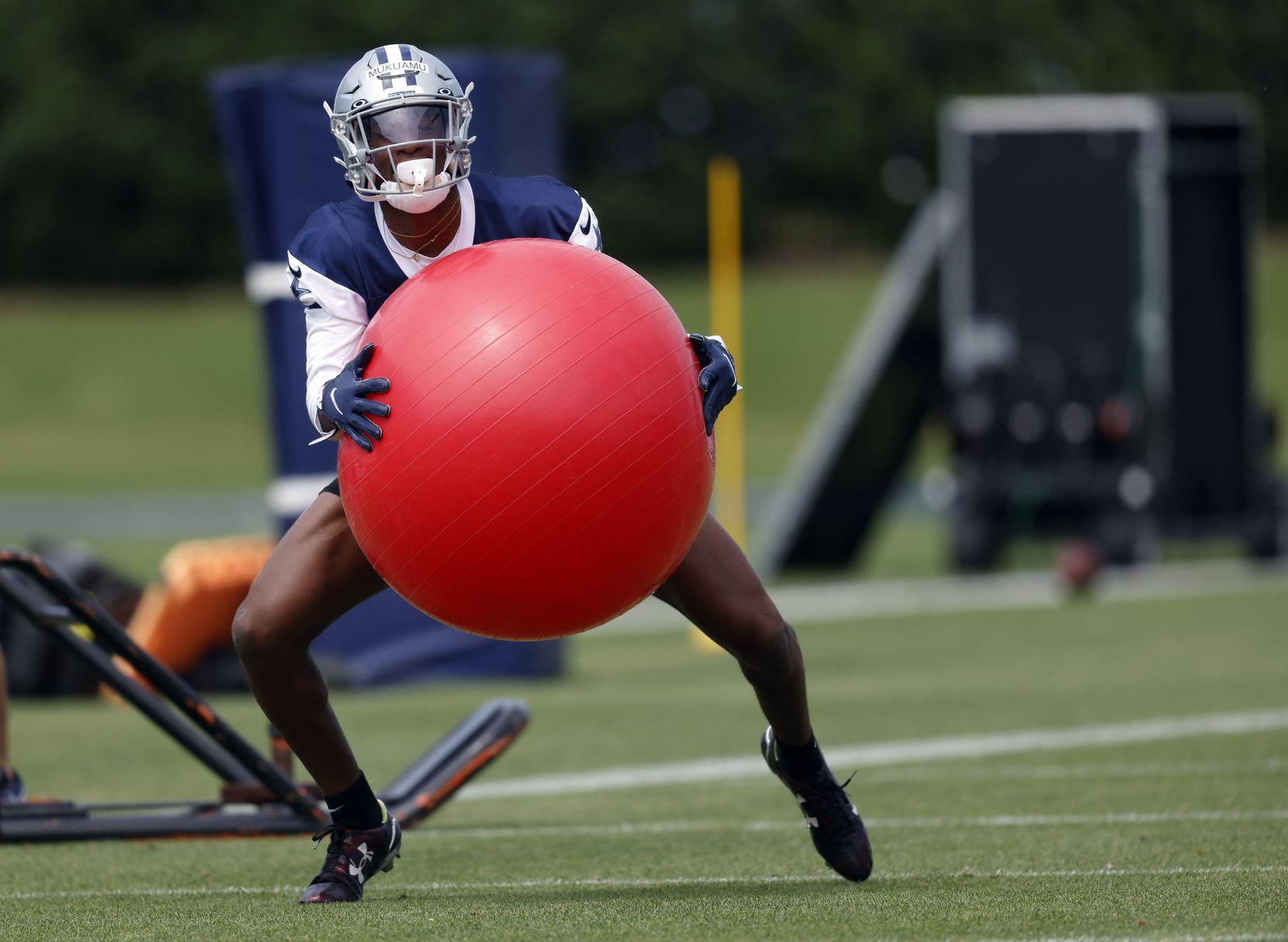 Dallas Cowboys rookie cornerback Israel Mukuamu (38) runs through drills at rookie minicamp at the The Star in Frisco, Texas, Friday, May 14, 2021. (Tom Fox/The Dallas Morning News)