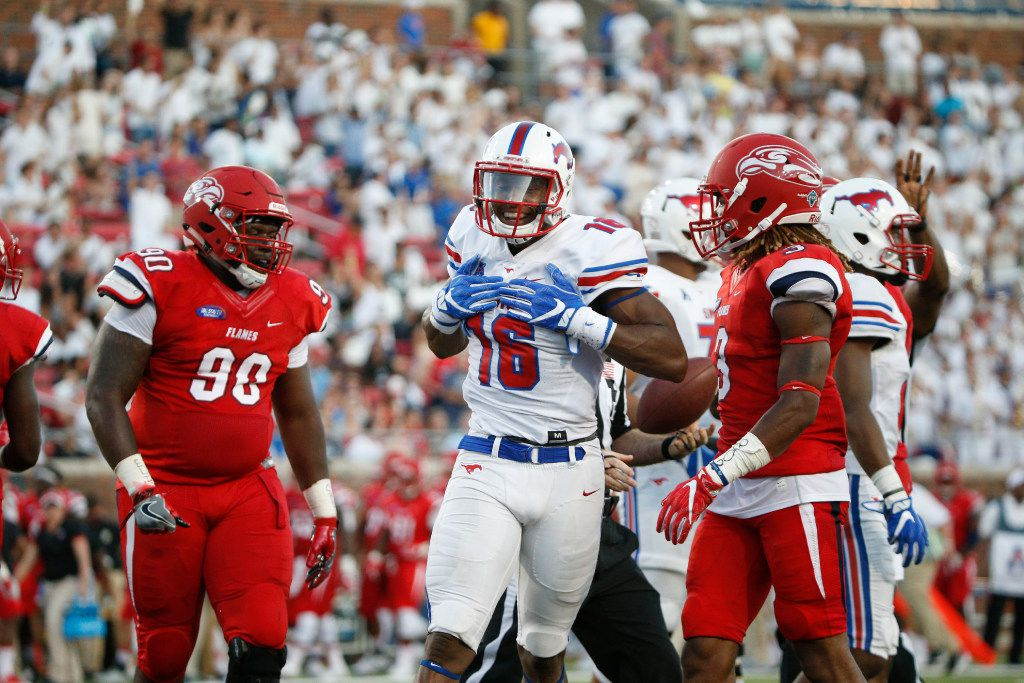 Southern Methodist Mustangs wide receiver Courtland Sutton (16) celebrates after he runs the ball for long yardage after a reception against Liberty Flamesin the first half at Gerald J. Ford Stadium in Dallas, Texas on Saturday Sept. 17, 2016.  (Nathan Hunsinger/The Dallas Morning News)