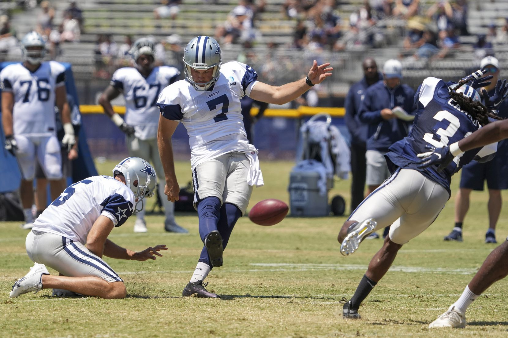 Dallas Cowboys punter Hunter Niswander (7) kicks a field goal from the hold of punter Bryan Anger (5) during a practice at training camp on Thursday, July 29, 2021, in Oxnard, Calif. (Smiley N. Pool/The Dallas Morning News)