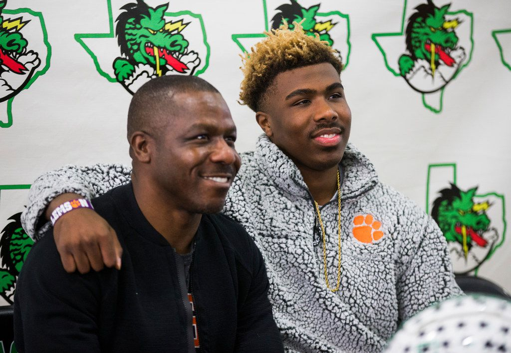 Southlake Carroll football player RJ Mickens (right) poses for a photo with his father, Ray Mickens, after signing a national letter of intent to attend Clemson University on Wednesday, December 18, 2019 at Southlake Carroll Senior High School in Southlake. (Ashley Landis/The Dallas Morning News)