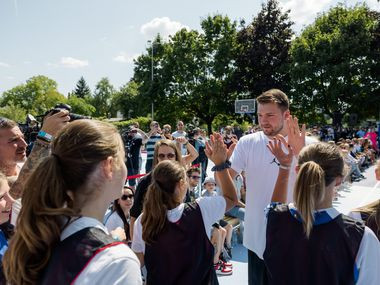 Luka Doncic give out high fives at the unveiling of the brand new courts he designed for his home town of Ljubljana, Slovenia. The new courts were part of a charitable effort from Doncic and 2K Foundations, the philanthropic arm of 2K.