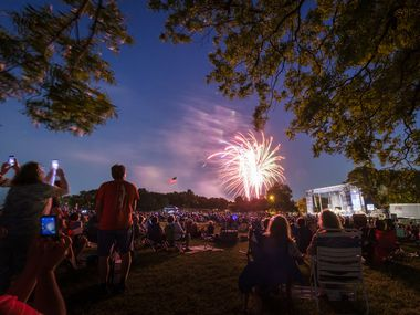 Fireworks light up the sky at the conclusion of the Dallas Symphony Orchestra's annual Memorial Day concert at Flag Pole Hill on Monday, May 27, 2019, in Dallas. (Smiley N. Pool/The Dallas Morning News)