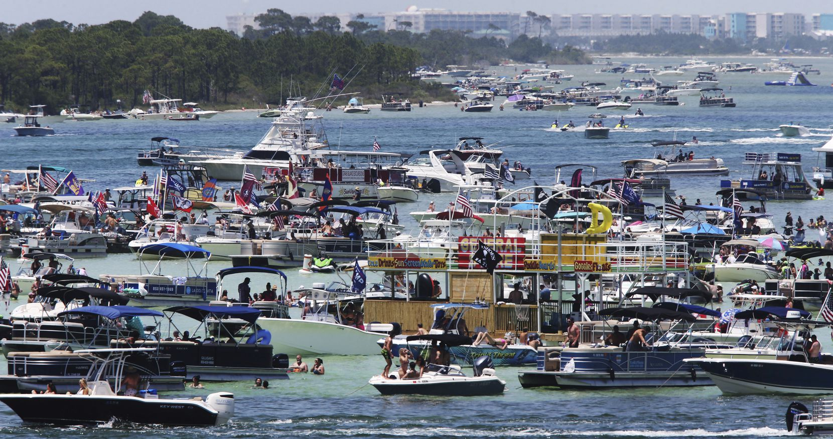 """Boaters crowded an area known as """"Crab Island"""" in the shallow waters near Destin Fla., over Memorial Day weekend."""