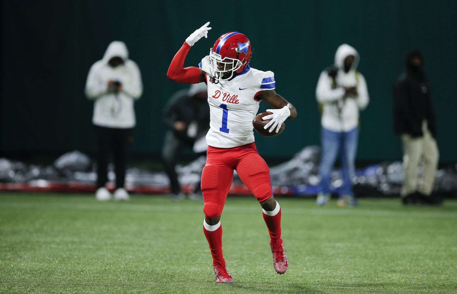 Duncanville senior running back Chris Hicks celebrates a touchdown during the first half of a Class 6A Division I Region II final high school football game against DeSoto, Saturday, January 2, 2021. (Brandon Wade/Special Contributor)