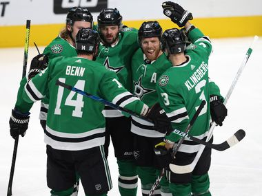 Dallas Stars right wing Alexander Radulov (47) is congratulated by teammates Dallas Stars center Joe Pavelski (16), Dallas Stars left wing Jamie Benn (14), Dallas Stars defenseman John Klingberg (3), and Dallas Stars left wing Roope Hintz (24) after Radulov scored a goal in a game against the Nashville Predators during the second period of play in the Stars home opener at American Airlines Center on Friday, January 22, 2021 in Dallas.