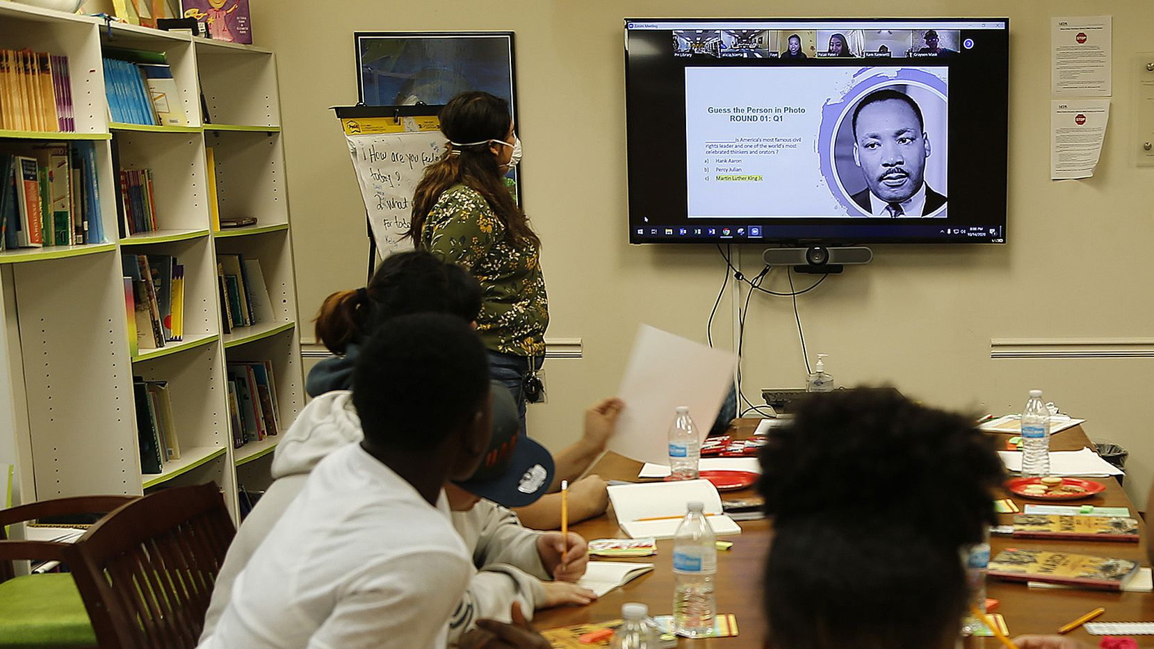 Youths take part in a book club at Promise House, a shelter and service agency for homeless and at-risk children.