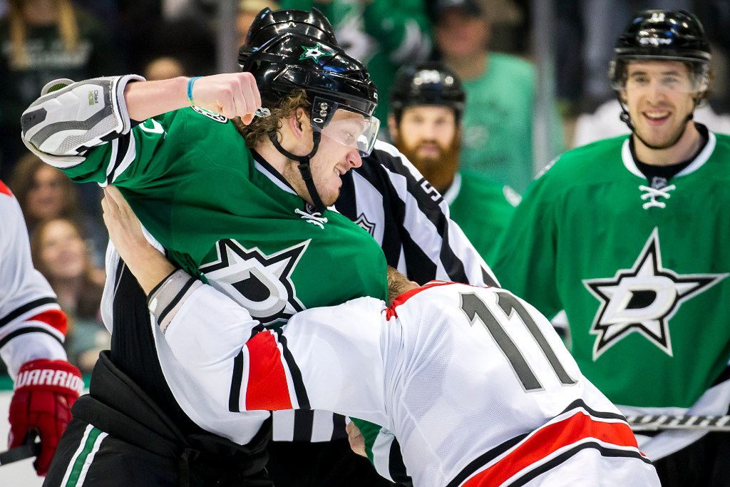 Dallas Stars defenseman Jamie Oleksiak (5) fights Carolina Hurricanes center Jordan Staal (11) during the third period of an NHL hockey game at the American Airlines Center on Saturday, Feb. 11, 2017, in Dallas. (Smiley N. Pool/The Dallas Morning News)