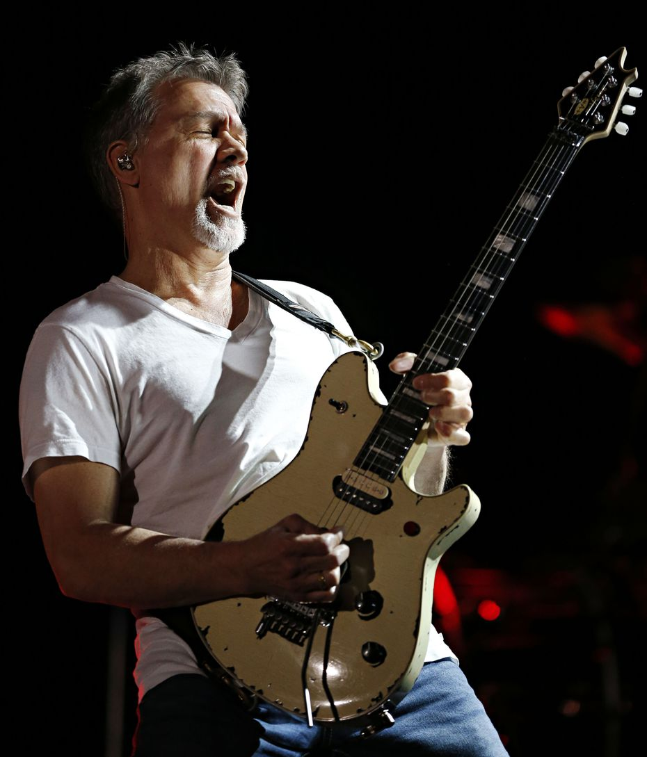 Eddie Van Halen played a solo during a performance by the rock band Van Halen on Sept. 23, 2015, at Gexa Energy Pavilion in Dallas. The legendary guitarist died of throat cancer on Oct. 6 at age 65.