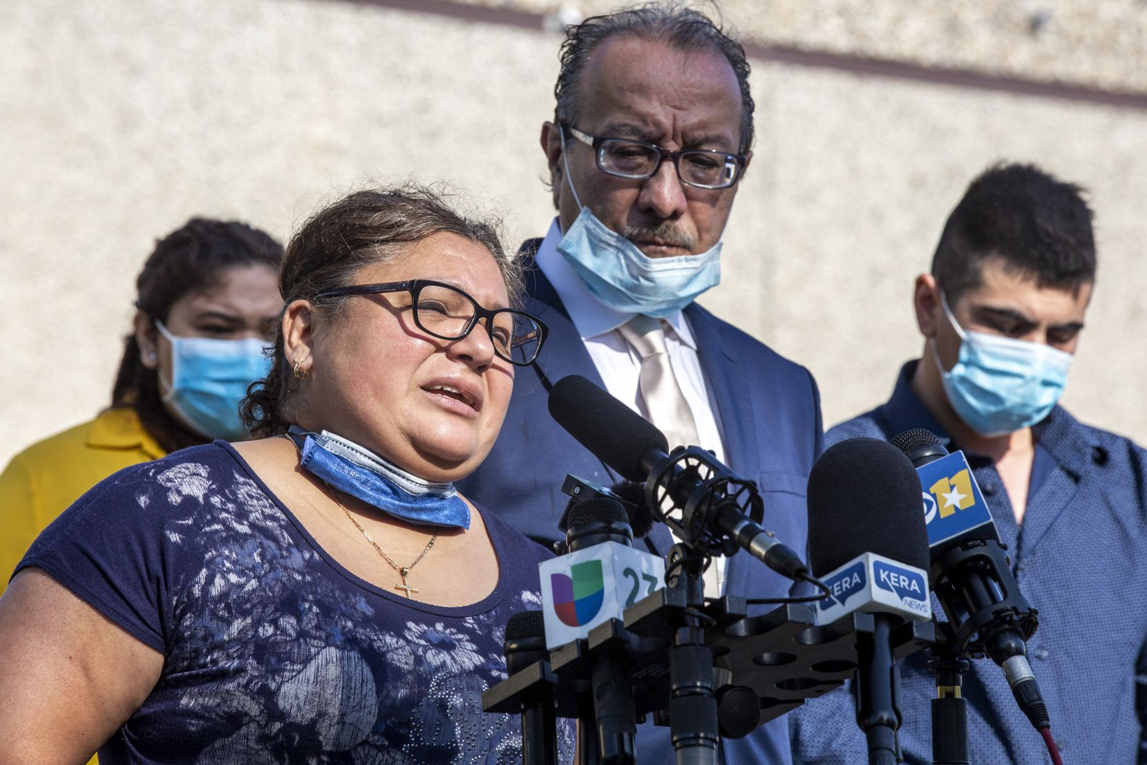 Blanca Parra, the wife of Hugo Dominguez, spoke about his death from COVID-19 at a news conference April 28 at the Quality Sausage Co. in Dallas. Parra has sued the company for wrongful death, alleging that it encouraged workers, including Dominguez, to keep working throughout the pandemic.