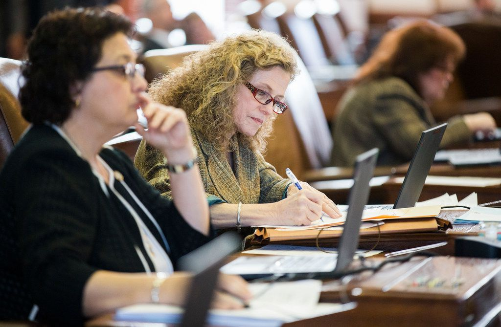 Rep. Donna Howard , right, takes notes at her desk Wednesday as the House took up rules and housekeeping measures with stronger provisions for investigating sexual harassment. Howard, D-Austin, helped draft the beefed-up procedures.