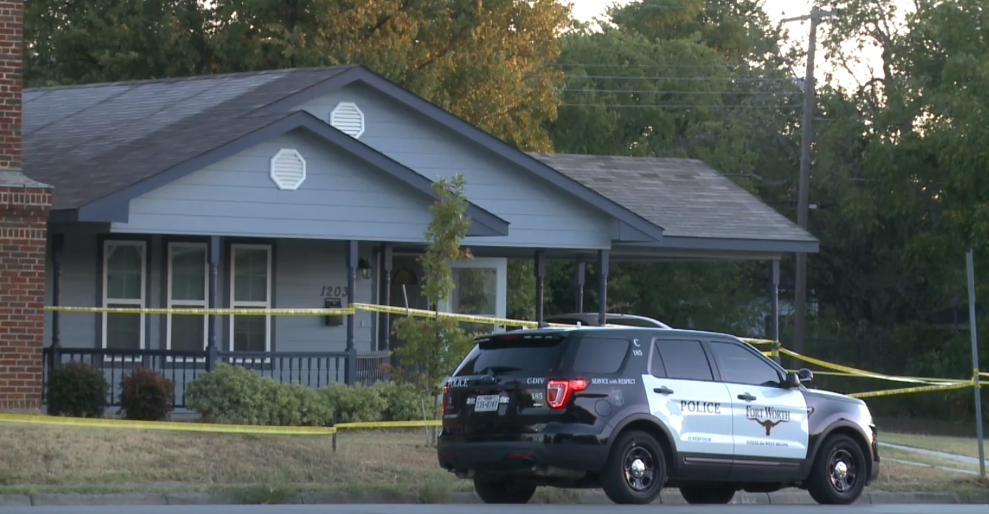 A Fort Worth police vehicle and crime scene tape outside the house where 28-year-old Atatiana Jefferson was fatally shot by a police officer early Saturday, Oct. 12, 2019.