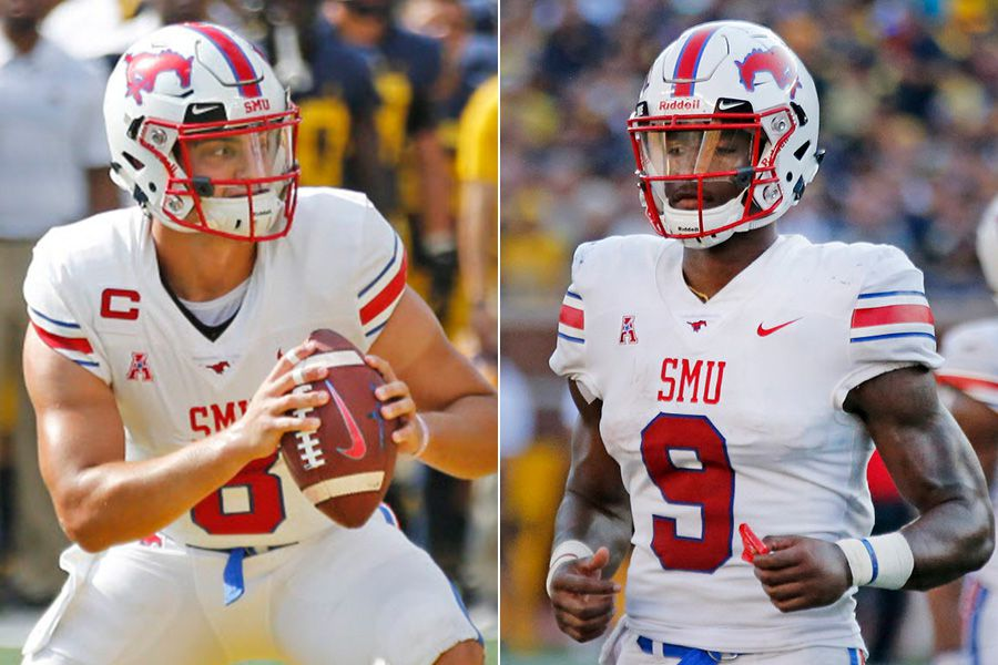 Quarterbacks Ben Hicks (left) and William Brown are pictured before SMU's game at Michigan on Saturday, Sept. 15, 2018.