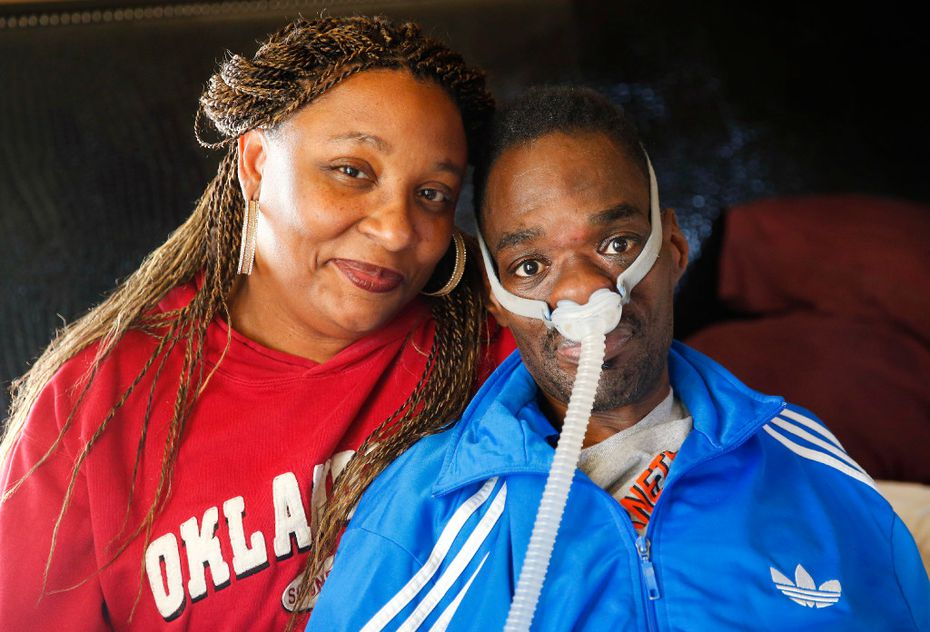 Former Cincinnati Bengal and Los Angeles Raider and ALS patient Rickey Dixon poses for a photo with his wife Lorraine at their Red Oak, Texas home, Friday, April 7, 2017.