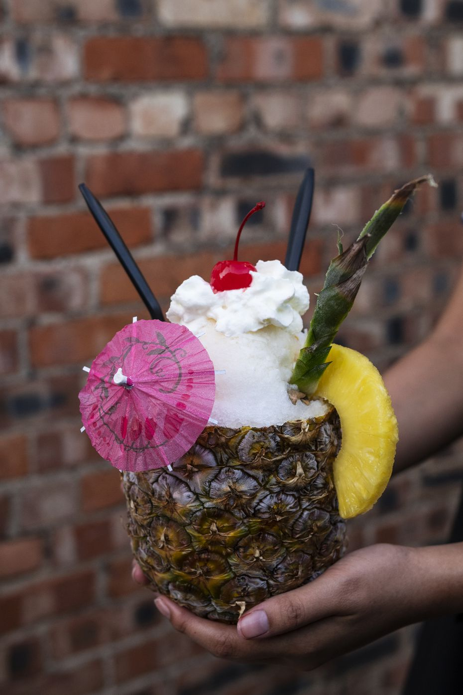 The Pina Alotta, made with house made pineapple and coconut syrup, whipped cream and vanilla ice cream, is one of the ice-cold creations at Shaved Balls of Ice in Deep Ellum.