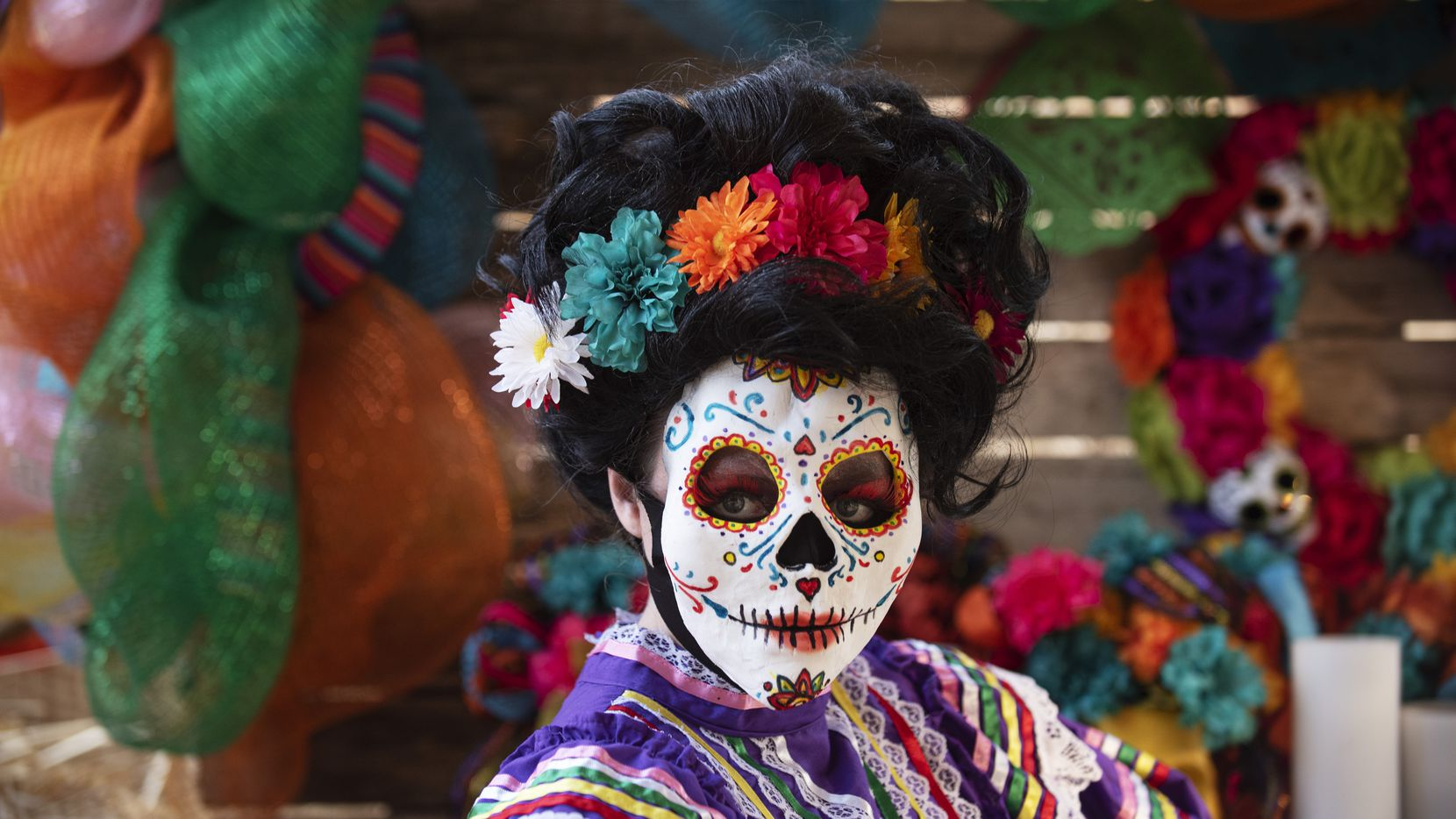 A Dia de los Muertos character named Valentina poses before meeting families at the Mystic Acres Trick or Treat Trail part of the Six Flags Hallowfest in Arlington, Saturday, Oct. 03, 2020. The city of Garland will hold an event for families looking for an alternative to in-person celebrations.