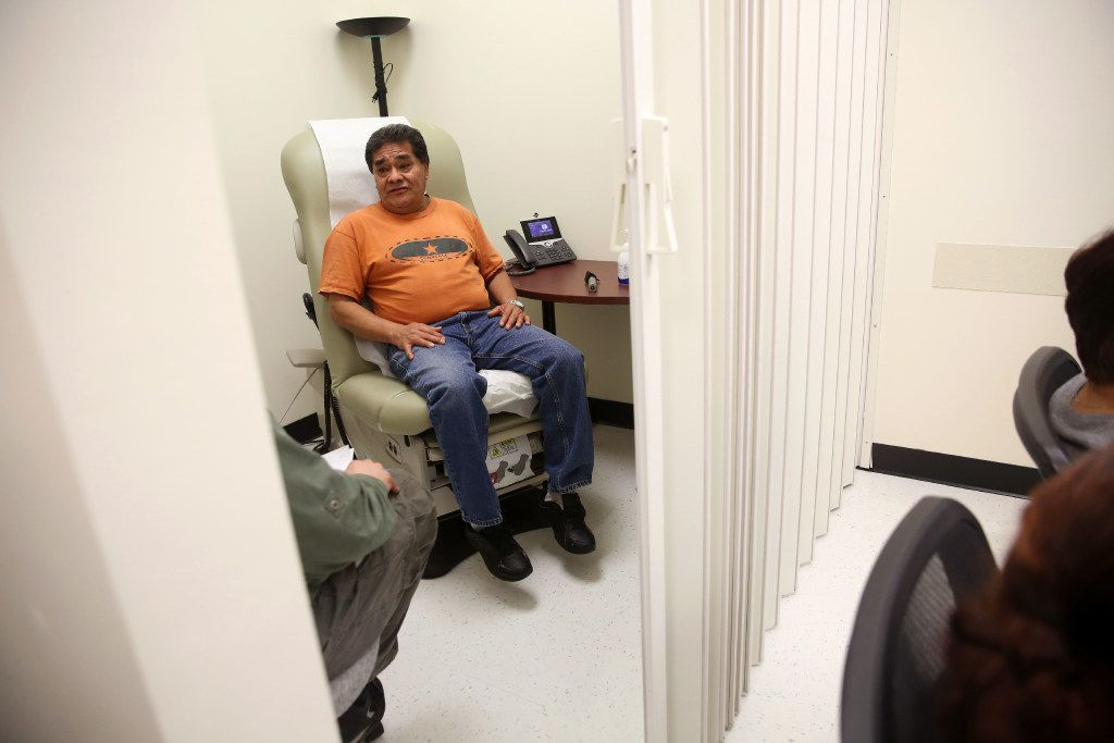 Juan Angon waits for his private exam during a shared medical appointment for patients with diabetes at Parkland Hospital's Vickery Health Center in Dallas last year. (Rose Baca/The Dallas Morning News)
