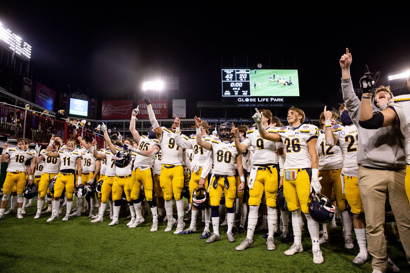 Highland Park players sing their school song after winning a Class 5A Division I area-round playoff game against Frisco Independence at Globe Life Park in Arlington on Thursday, Dec. 17, 2020. Highland Park won 42-20. (Juan Figueroa/ The Dallas Morning News)