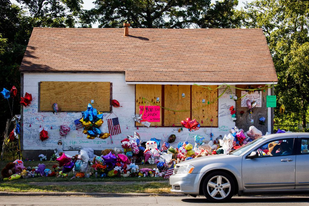 Messages, flowers, balloons and stuffed animals filled the yard and walls of the abandoned house on East Kiest Boulevard in Dallas where the body of 13-year-old Shavon Randle of Lancaster was found in July 2017.