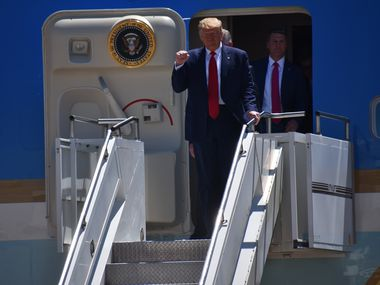 President Donald Trump pumps his fist as he steps off Air Force One upon arrival in Dallas on June 11, 2020, where he hosted a roundtable with faith leaders and small business owners.