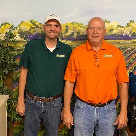Collin Hunn (left) is vice president and Pat Hunn is president of Garland-based First Place Foods. The family-owned and -operated business produces pickles and jalapeno peppers under the Hunn's brand.