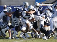 Dallas Cowboys linebacker Leighton Vander Esch (55) tackles running back Tony Pollard (20) on a play during training camp at the Dallas Cowboys headquarters at The Star in Frisco, Texas on Friday, August 21, 2020.