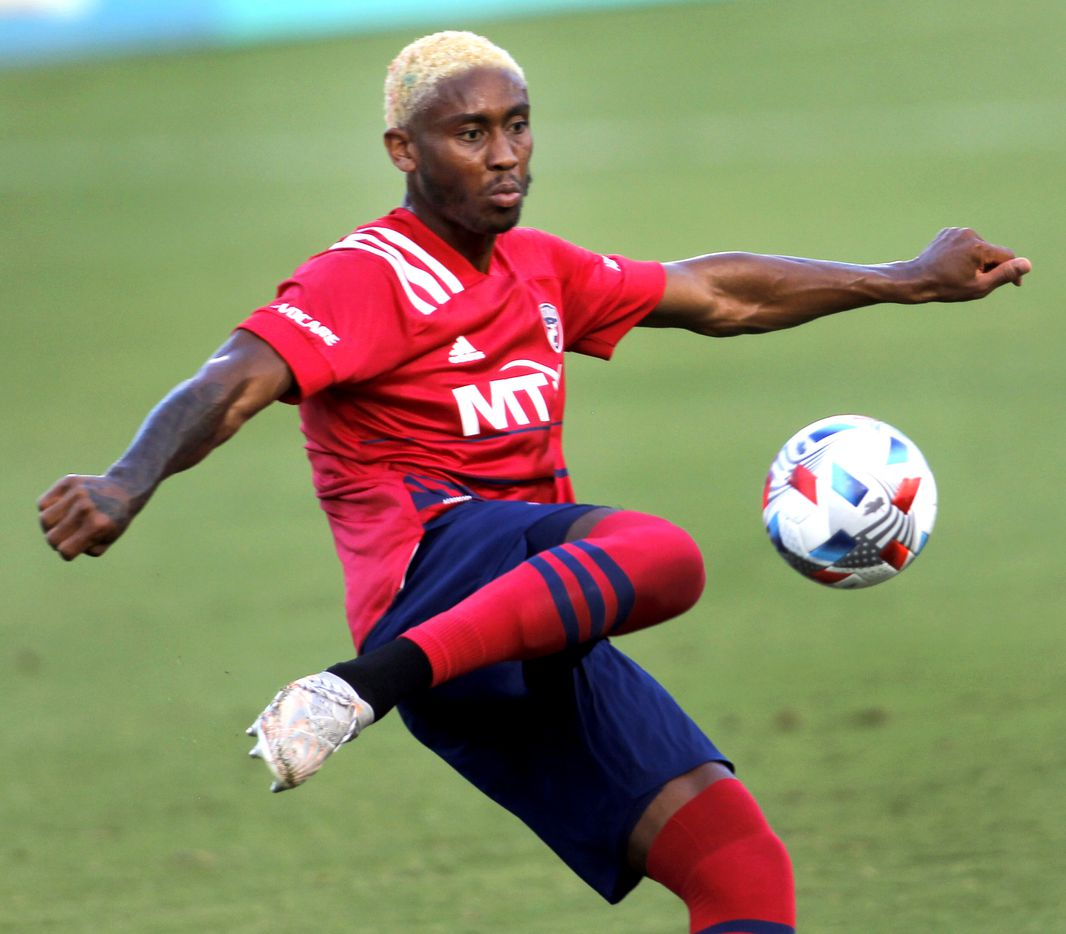 FC Dallas defender Nkosi Burgess (14) preps to clear the ball from outside the FC Dallas goal during first half action against Vancouver. The two Major League Soccer teams played their match at Toyota Stadium in Frisco on July 4, 2021. (Steve Hamm/ Special Contributor)