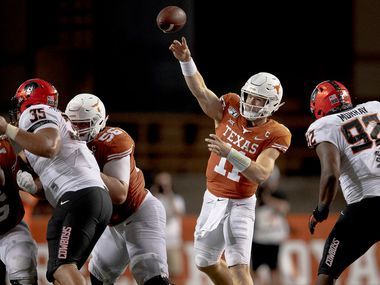 Texas quarterback Sam Ehlinger (11) throws the ball against Oklahoma State on Saturday, Sept. 21, 2019, at Royal Texas Memorial Stadium in Austin, Texas. The host Longhorns won, 36-30. (Nick Wagner/Austin American-Statesman/TNS)