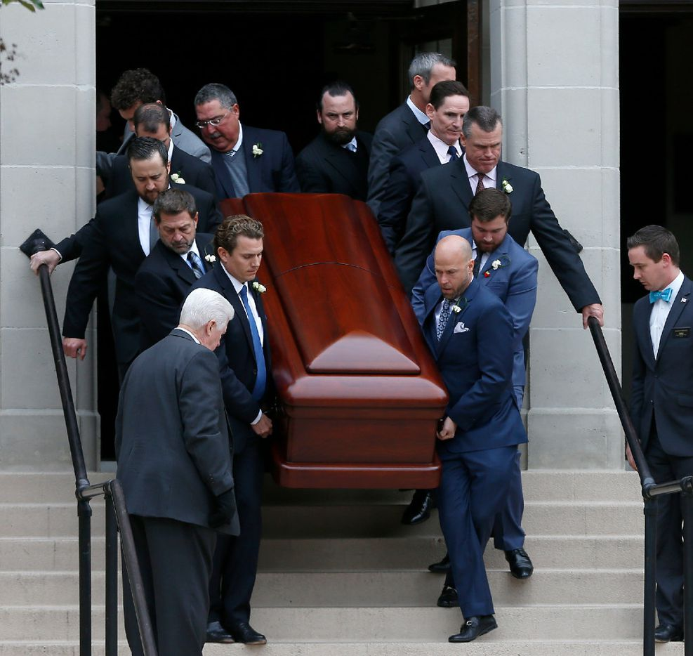 Pallbearers carried the casket of attorney Brian Loncar at Munger Place Church in Old East Dallas following his funeral on Dec. 9. (Jae S. Lee/Staff Photographer)