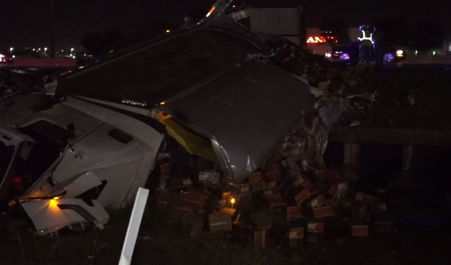 An 18-wheeler spilled hundreds of boxes of chicken after it overturned Tuesday on Interstate 20 in Arlington.