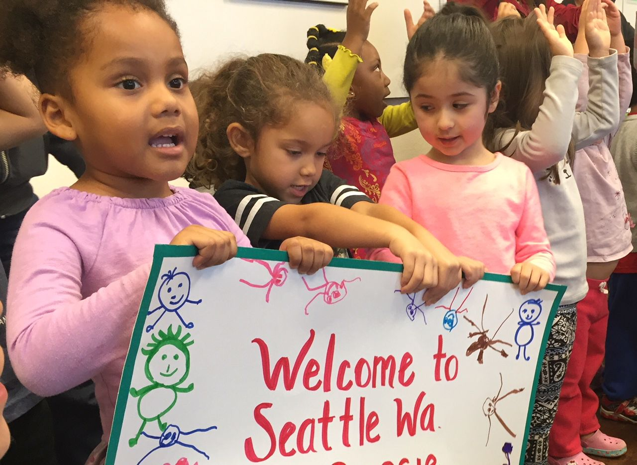Seattle children greet Bessie Rodriguez of Dallas in a Day of the Dead homage to her slain son on Nov. 2, 2015. A park at the Seattle nonprofit is named in honor of Santos.