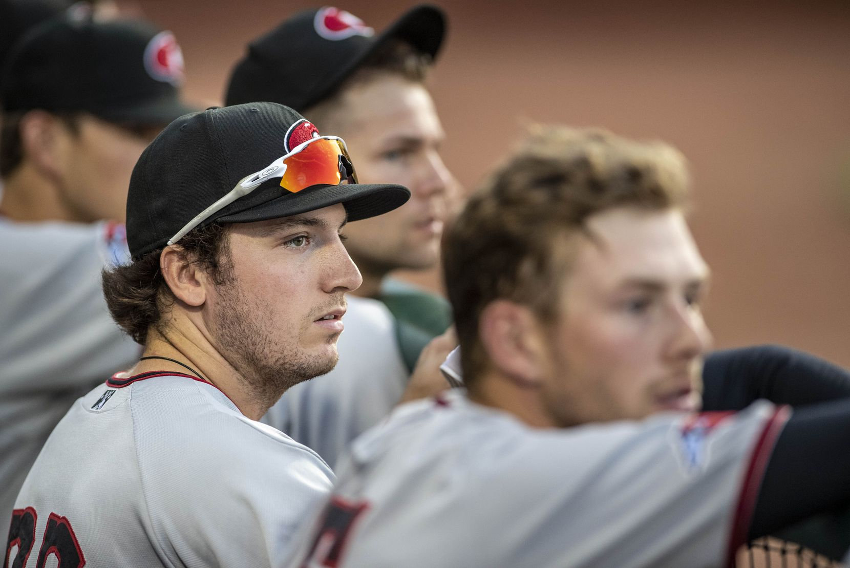 Hickory Crawdad's Trevor Hauver (33) watches the game with the Greensboro Grasshoppers from the dugout at First National Bank Field on Thursday, August 5, 2021 in Greensboro, N.C.