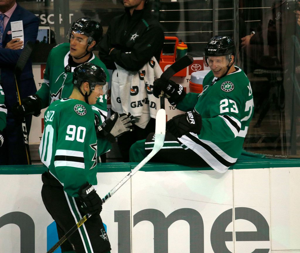 Dallas Stars center Jason Spezza (90) celebrates scoring a goal with defenseman Esa Lindell (23) against the St. Louis Blues during the third period of their hockey game at American Airlines Center in Dallas on Sept. 18, 2018. Dallas Stars won the game 5-3. (Nathan Hunsinger/The Dallas Morning News)