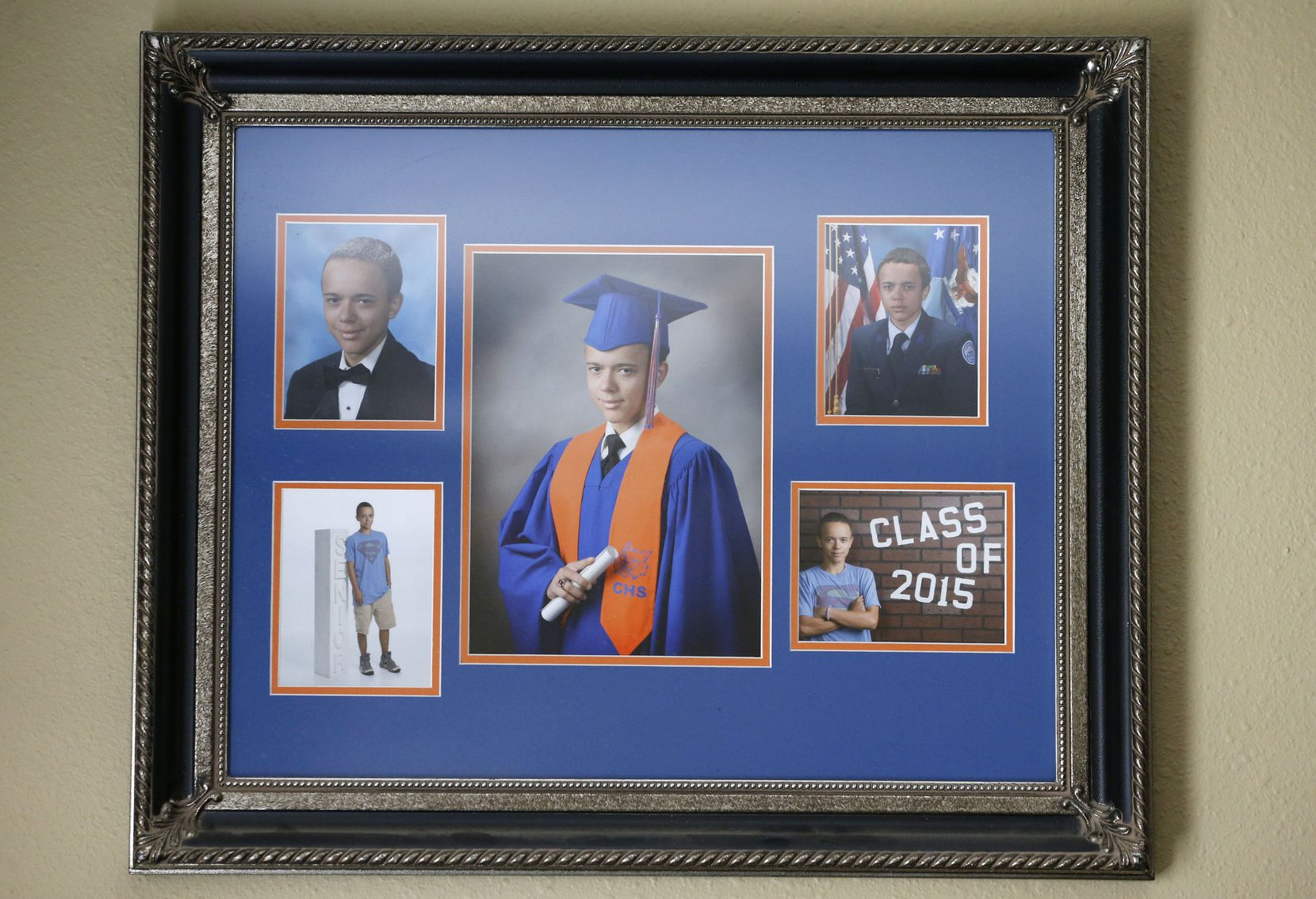 Isaac L. DeLeon's high school portraits hang on the wall at his family's home in San Angelo.