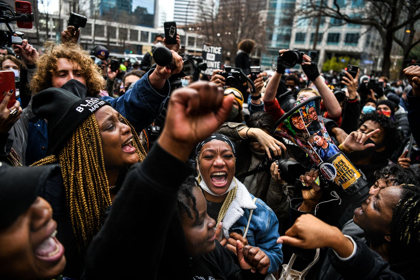 People celebrate as the verdict is announced in the trial of former police officer Derek Chauvin outside the Hennepin County Government Center in Minneapolis, Minnesota on April 20, 2021. - Sacked police officer Derek Chauvin was convicted of murder and manslaughter on april 20 in the death of African-American George Floyd in a case that roiled the United States for almost a year, laying bare deep racial divisions.