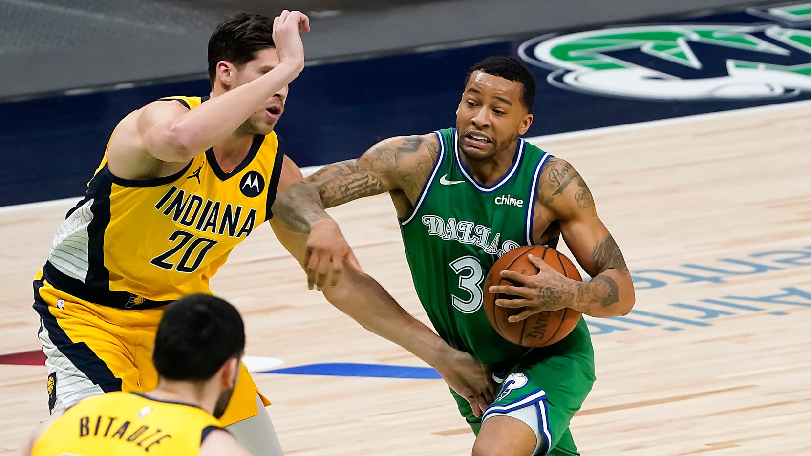 Dallas Mavericks guard Trey Burke (3) drives to the basket against Indiana Pacers forward Doug McDermott (20) during the first half of an NBA basketball game at American Airlines Center on Friday, March 26, 2021, in Dallas. (Smiley N. Pool/The Dallas Morning News)