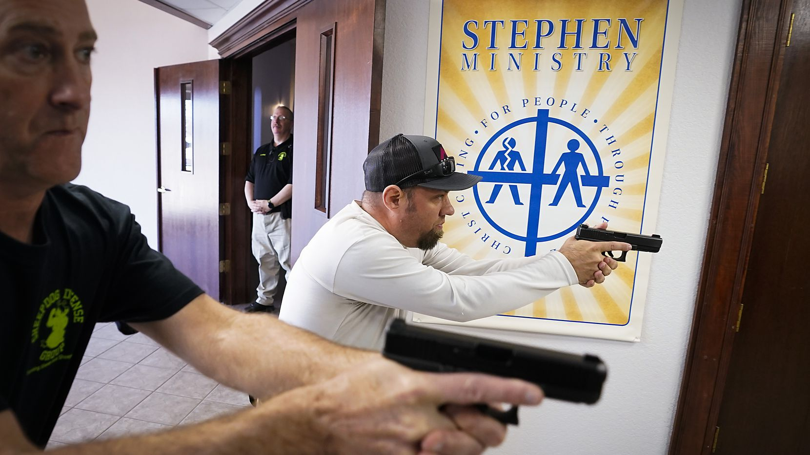 Jason Johnston, from Fellowship of the Parks Church in Grapevine (right), and  Les Davis, from Creek Church in Saginaw, practice searching and clearing a hallway during a Sheepdog Defense Group armed security programs church safety training session at Cornerstone Community Church on Sunday, Feb. 2, 2020 in Springtown, Texas.